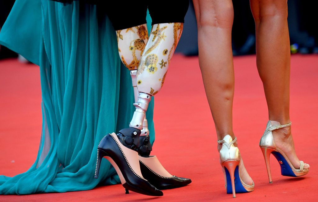 Prosthetics with stiletto heels, belly-pieces, tattoos and daring looks: the best of the Venice red carpet